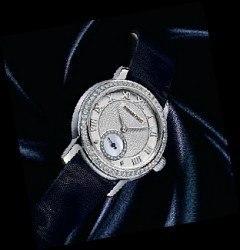 Selbstbewusste Klassikerin mit festlichem Armband aus Moiré-Seide: Ladies' Jules Audemars von Audemars Piguet (15 300 Euro)