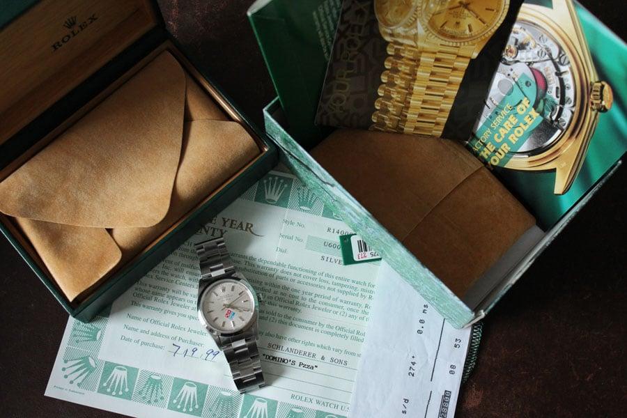 Eine Rolex Air-King Domino's Pizza mit Originalbox und Garantieschein