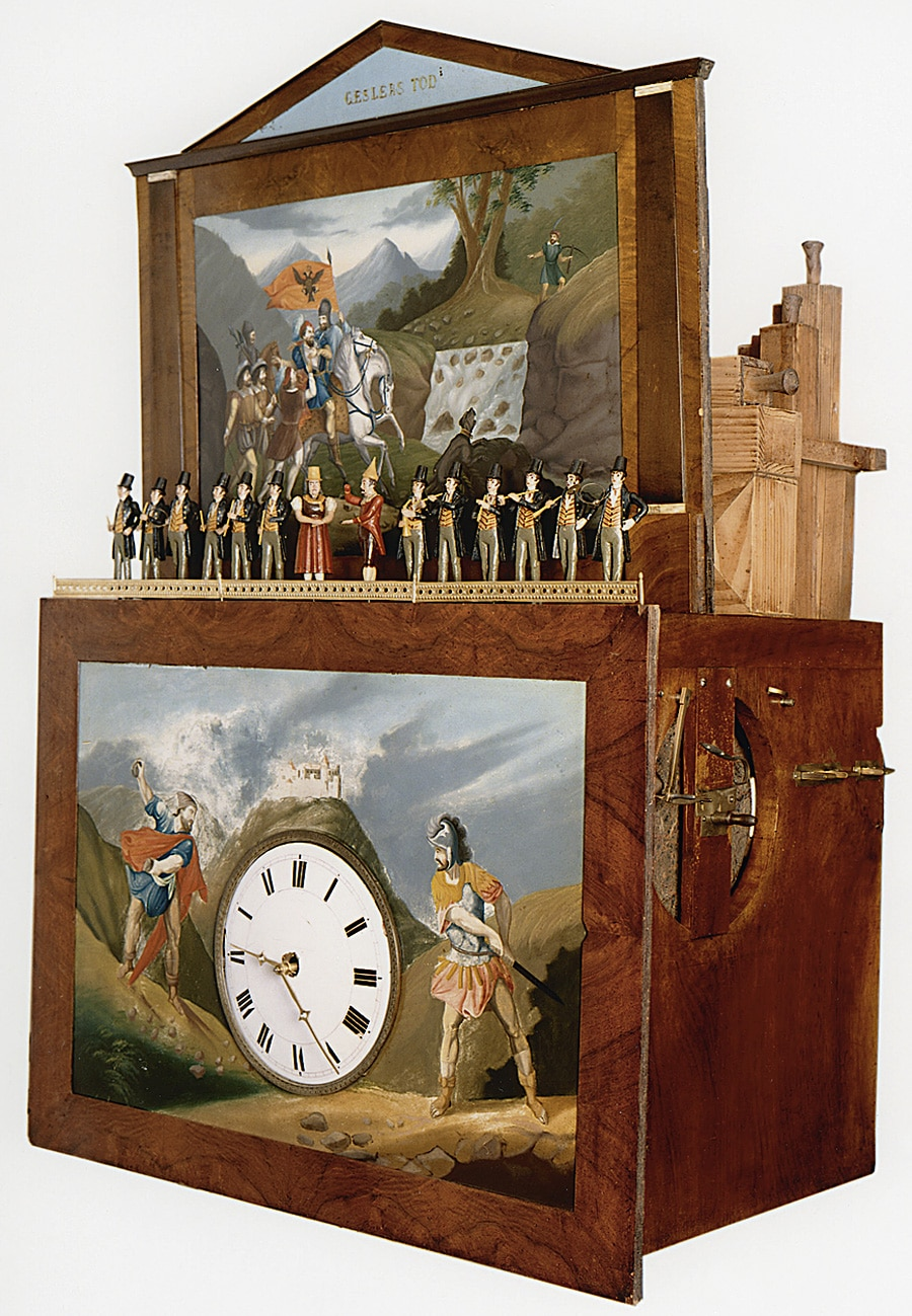 """Flötenuhr mit Szene aus Schillers """"Wilhelm Tell"""": Das Musikwerk spielt nach dem Stundenschlag eine von zwölf Melodien, dazu bewegen sich 14 Figuren. Leodegar Dufner, Furtwangen, um 1840"""