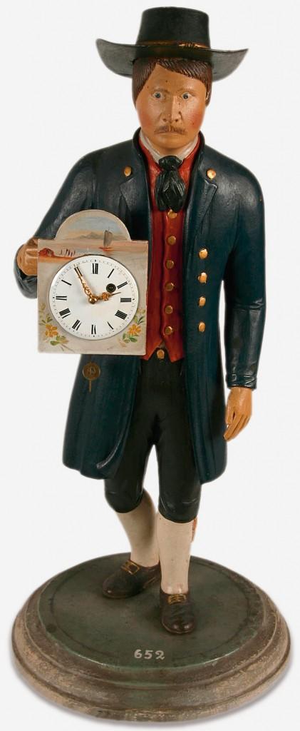 Uhrenmännchen in Gestalt eines hausierenden Uhrenverkäufers; die Händler reisen einst auf Jahre ins europäische Ausland und nach Amerika. Wohl aus Messkirch, zweite Hälfte 19. Jahrhundert