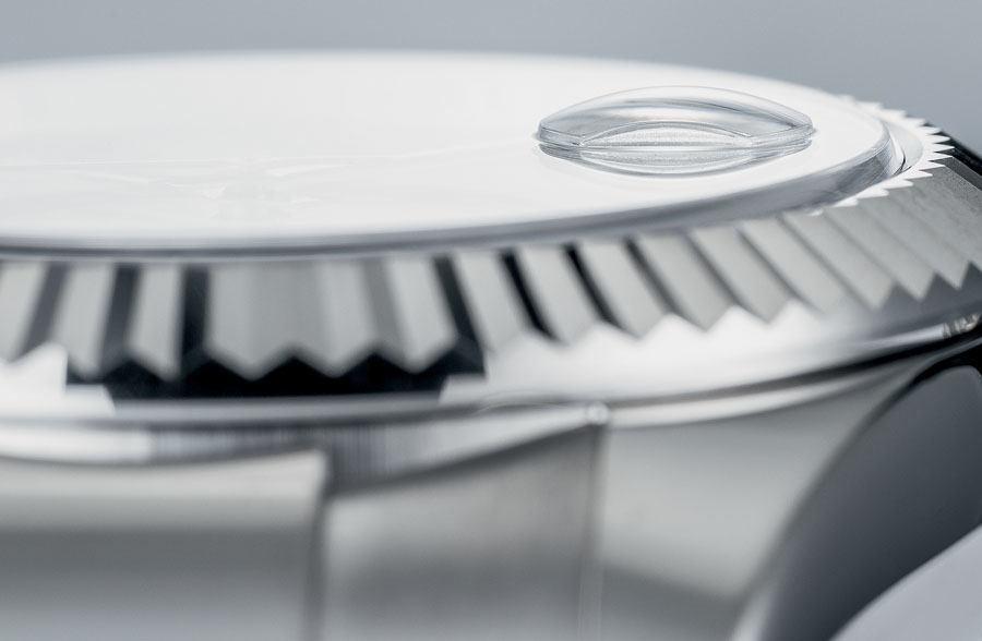 Symbol für das gut ablesbare Datum: die Lupe der Rolex Datejust