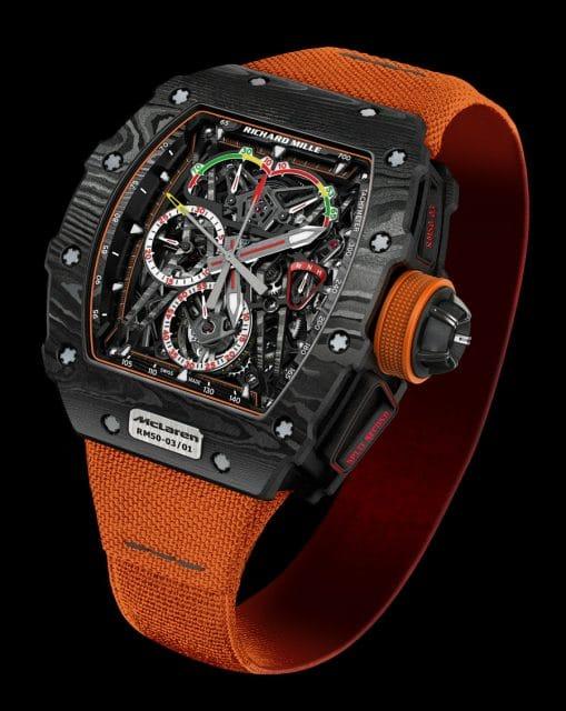 Das Richard Mille RM 50-03 Tourbillon Split Seconds Chronograph Ultralight McLaren F1 ist aktuell der leichteste Chronograph weltweit. Auch sein Manufakturkaliber RM 50-03 mit Handaufzug ist ultraleicht. Es bietet ein Tourbillon und einen Schleppzeiger-Chronographen.