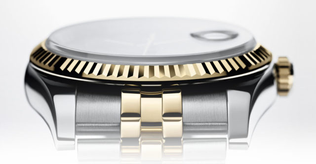 Typische Markmale des Rolex-Designs: Datumslupe, geriffelte Lünette, Metallband