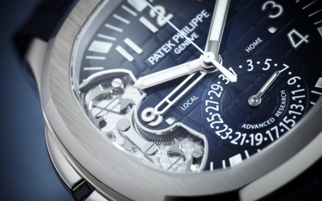 Bei der Patek Philippe Aquanaut Travel Time Ref 5650G Advanced Research zeigt ein Zifferblattauschnitt das neue Stellorgan