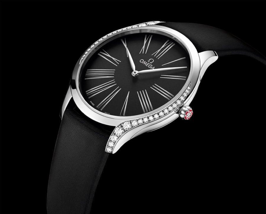 Omega: Trésor in Edelstahl mit schwarzem Zifferblatt am farblich passenden Band